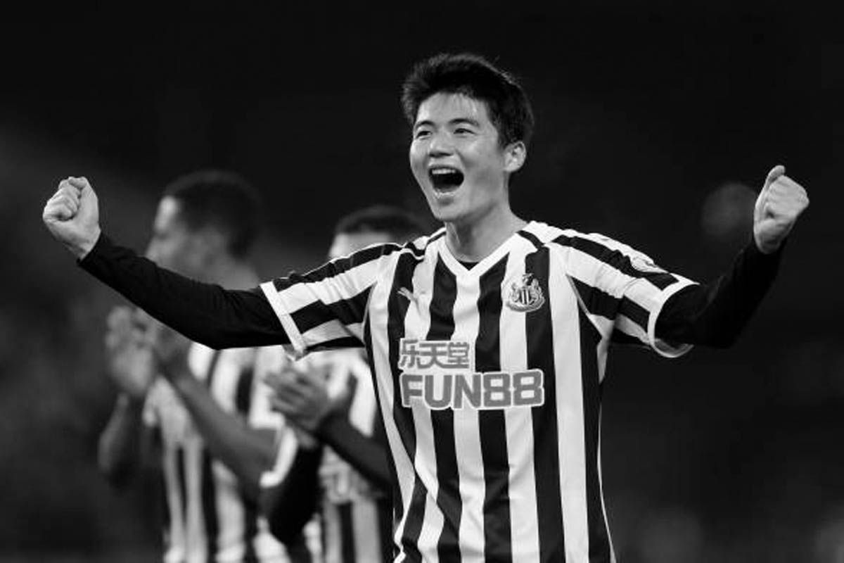 Ki Sung-yueng celebrates with fans following Newcastle United's 2-1 victory over Burnley in the Premier League.