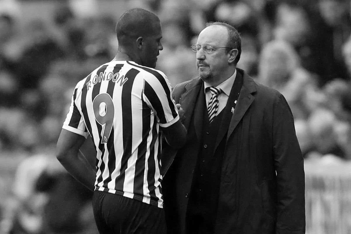 Salomon Rondon embraces Newcastle United manager Rafa Benitez.