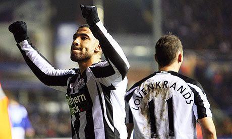 Leon Best celebrates with Peter Lovenkrands after putting Newcastle two up away to Birmingham.