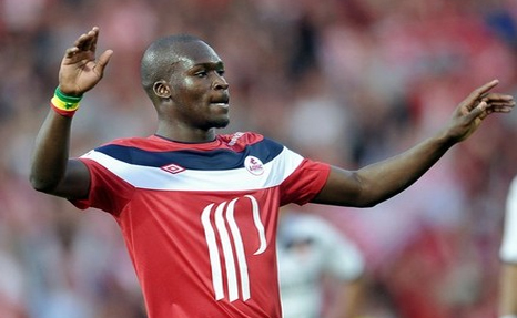 Moussa Sow celebrates after scoring a goal for Lille