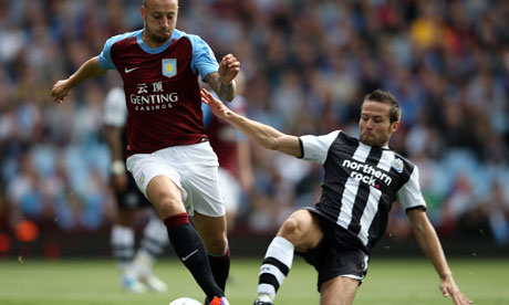 Yohan Cabaye makes a tackle on Aston Villa's Alan Hutton in the Premier League