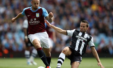 Yohan Cabaye makes a tackle on Aston Villa's Alan Hutton in the Premier League