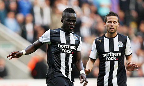 Cheik Tioté and Yohan Cabaye in action for Newcastle United in St.James' Park