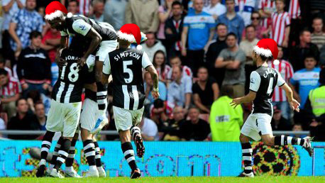 Newcastle United celebrate Ryan Taylor's winning free-kick against Sunderland