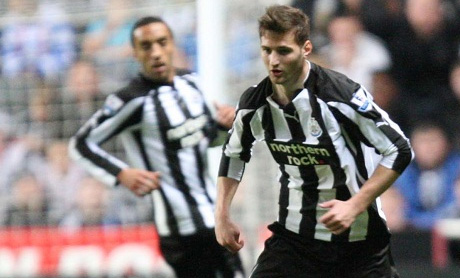 Tamás Kádár and James Perch in action for Newcastle United