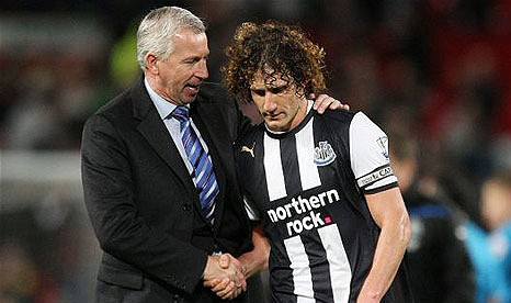 Fabricio Coloccini and Alan Pardew shake hands following Newcastle United's draw at Old Trafford