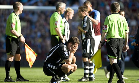 Steven Taylor heartbroken on the pitch at Villa Park following relegation