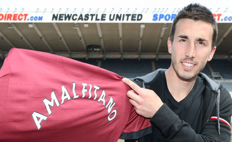 Romain Amalfitano holds a Newcastle United jersey at St.James' Park