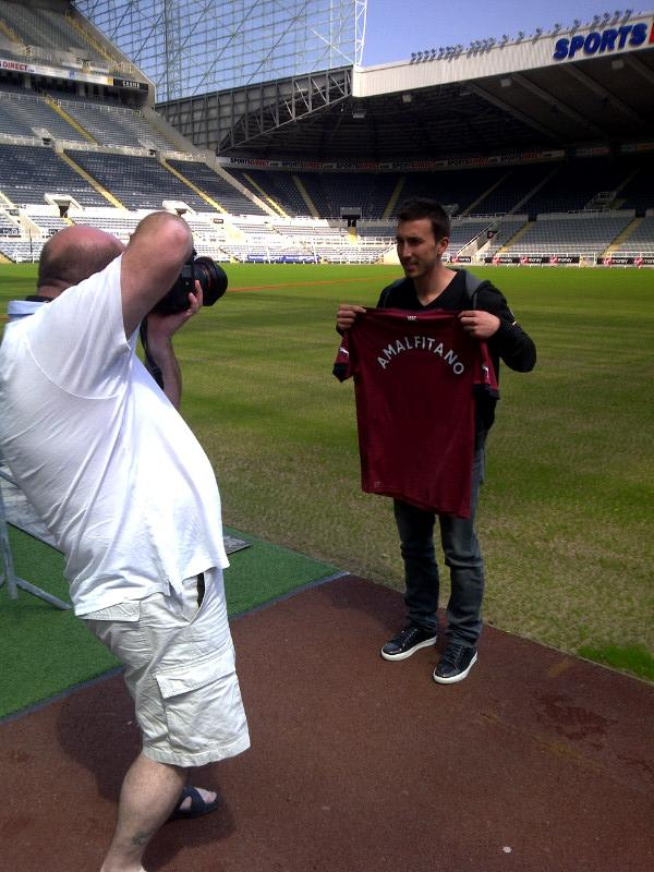 Romain Amalfitano holds a Newcastle United jersey