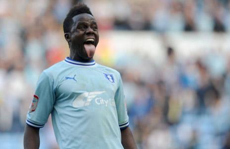 Gael Bigirimana celebrates a derby win for Coventry City