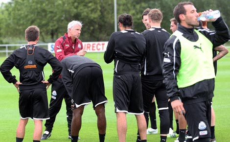 Xisco takes a drink at a Newcastle United training session