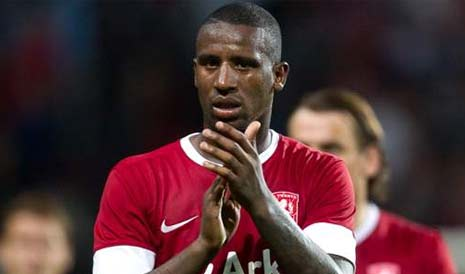 Douglas applauds the FC Twente crowd after their league match