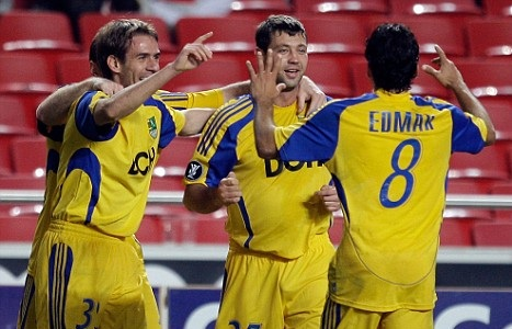 Metalist celebrate after scoring against Manchester City