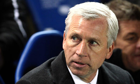 Alan Pardew looks on during a Premier League game