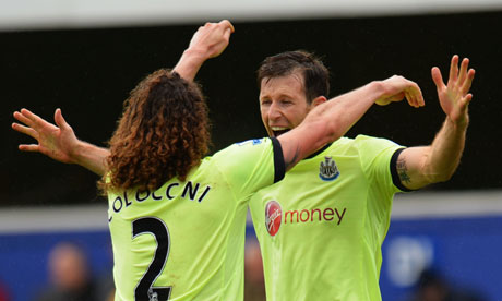 Fabricio Coloccini and Mike Williamson celebrate at Loftus Road