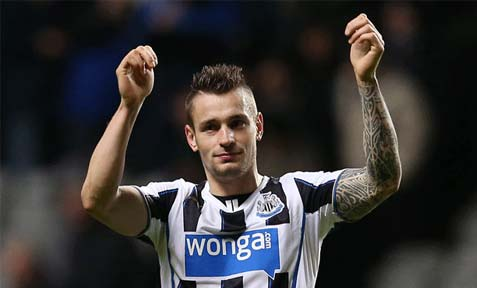 Mathieu Debuchy salutes in Newcastle United supporters
