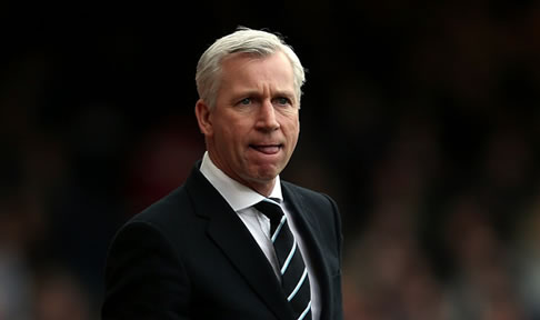 Alan Pardew watches his side take on West Ham United