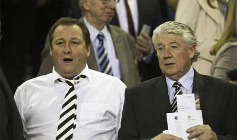 Mike Ashley and Joe Kinnear sit in the stands watching Newcastle United