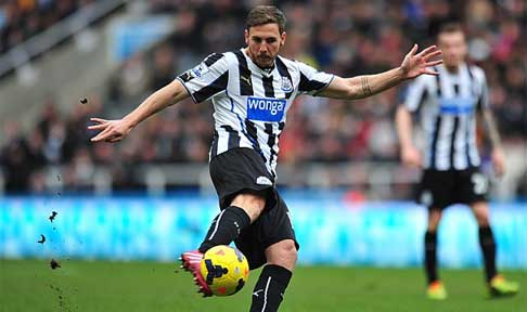 Dan Gosling in action for Newcastle United against Manchester United