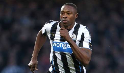Shola Ameobi in action against Manchester City