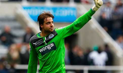 Tim Krul waves to fellow teammates during Newcastle's encounter with Manchester City