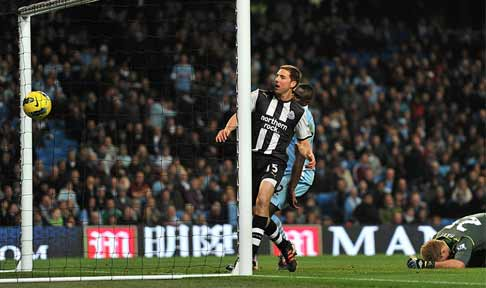 Dan Gosling scores against Manchester City in the Premier League