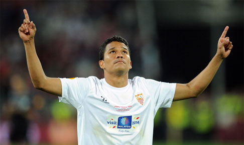 Carlos Bacca celebrates after scoring for Sevilla