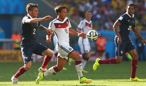Mathieu Debuchy battles for possession with Germany's Mario Gotze