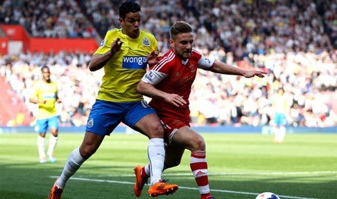 Hatem Ben Arfa tussles for posession with Luke Shaw of Southampton