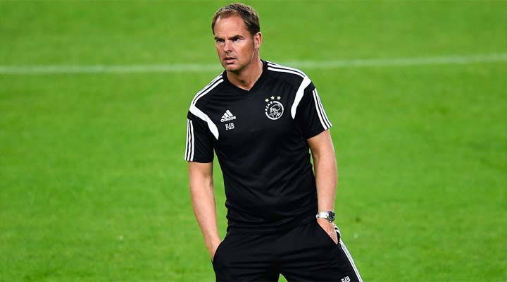 Frank De Boer watches his Ajax side warm-up against Barcelona