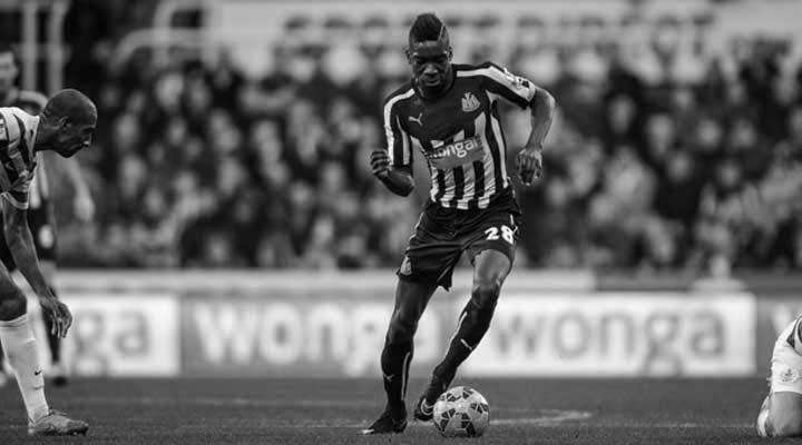 Sammy Ameobi takes on Karl Henry of QPR