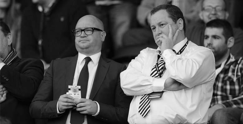 Lee Charnley and Mike Ashley look on during a Premier League game.